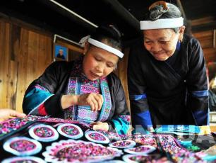 Broderande damer, Guizhou